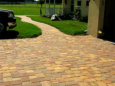 Beautiful paver driveway with a modern car.