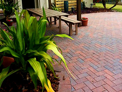 The exquisite beauty of a sealed paver driveway.