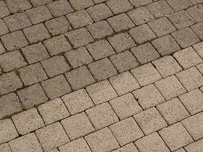 See the difference between pavers that are sealed and those not sealed.